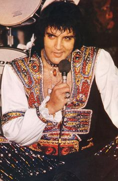 1975-This was the year I first saw this man perform. He was wearing this jumpsuit and as handsome as ever. He was in great voice, danced around the stage and so funny. I went on to see him in concert several times and he was just as wonderful and very sweet to me...I adore this man...t
