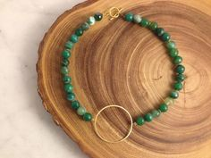 "Hand-made mixed green agate circle necklace by local Louisville artist, W&M Custom Jewelry. Bring it in with a statement piece right along the neckline!  Chain is 17"" is length."