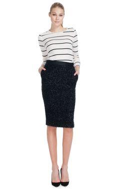 Glitter pencil skirt. 57% wool / 37% rayon / 10% polyester. By Malene Birger.