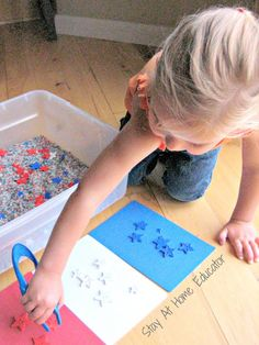 Fourth of July sensory bin, sorting star buttons by color - Stay At Home Educator