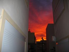 A classic deep red sunset over Cretan buildings posted in the BritsinCrete Forum