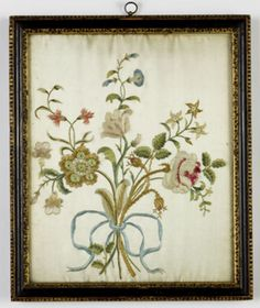 A fine Georgian silkwork picture of flowers retaining good colour throughout and within the original carved and giltwood frame. English circa 1780.