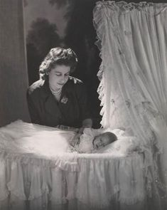 Queen Elizabeth II, Princess Elizabeth at the time, with baby Prince Charles in 1948. by christy