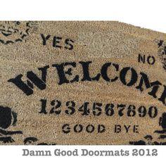 Ouija style board doormat Mystical spooky spirit contact. $50.00, via Etsy.