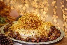 Gratin de batatas com queijo Ementhal e cebolas carameladas