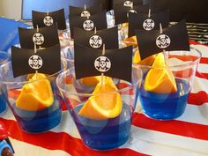 pirate ship blue jello cups w/ orange wedges & sails.