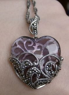 Amethyst and marcasite heart necklace.