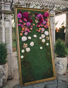Floral backdrop using large mirror frame and moss
