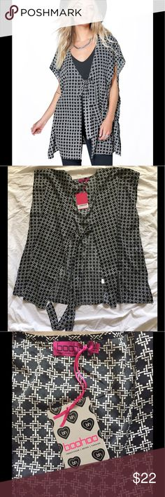 Tie Front Kimono Top This flowy kimono features a black and white knot motif and looks great worn over a tank or dress. It is listed as size xsmall and size 4 but I'd say the fit is oversized. It is brand new and has never been worn. Boohoo Tops