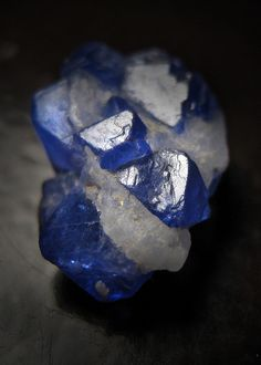 Blue Spinel from Afghanistan.  Most blue spinel is rather opaque and not very intensely colored, but these crystals from Afghanistan are...gemmy, fairly well-formed, and cobalt blue...    ..z