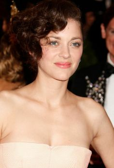 5 Wedding Hair and Makeup Lessons We Can Learn From the 2013 Met Gala | 1. Eyeliner is overrated. Oh, fine, its not. We all know eyeliner is amazing. BUT skipping the bold liner can be a statement unto itself, as Marion Cotillard showed. She traced her eyes in gold and champagne shimmer instead. This makeup would be so dreamy and ethereal for a bride.