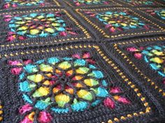 The pattern is the Stained Glass Window Afghan from the book Sensational Crochet Afghans and Throws...I used Caron Simply Soft in in Raspberry, Caron Simply Soft Brites in Limelight, Blue Mint, Mango, Lemonade, and Watermelon, and Caron Simply Soft Heathers in Charcoal Heather (about 11 skeins of the charcoal, about 1 skein each of the other colors).