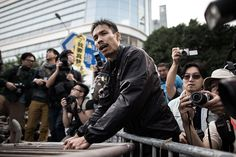 Umbrella Revolution Hong Kong, A pro-democracy protester removes a barricade outside the Citic tower near a protest site in the Admiralty district of Hong Kong on November 18, 2014. Security staff members assisted by Hong Kong bailiffs took action at pro-democracy barricades outside the building located near the main protest sites in the city, as pressure grows on demonstrators to leave. AFP PHOTO / Philippe Lopez (Photo credit should read PHILIPPE LOPEZ/AFP/Getty Images)