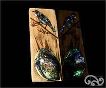 Recycled driftwood with polished paua shell and paua tui