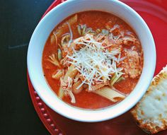 You haven't tried soup until you've tried this Chicken Parmesan Slow Cooker Soup! This slow cooker Italian chicken soup recipe tastes just like the classic dish you already know, but in the form of comforting soup.