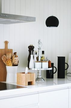 Raise miscellaneous (but needed) kitchen items to create visual space on the counter