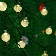 NEWSTYLE 16.4Ft 30 LED Crystal Ball Solar Powered Outdoor String Lights for Outside Garden Patio Party Christmas (Warm White) NEWSTYLE http://www.amazon.com/dp/B00PSGOZUC/ref=cm_sw_r_pi_dp_Sckevb1B5MYC9