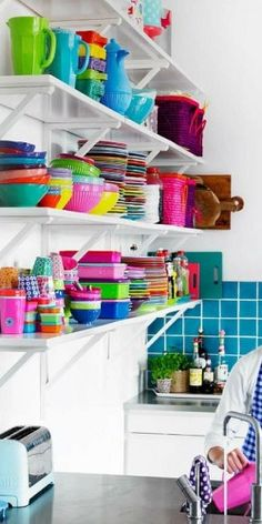The shelf contents add lots of color to an almost all white room.