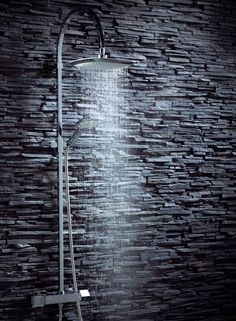 Combine a contemporary shower with a dark backdrop for an edgy look that will make the bathroom really stand out - Dream Shower from Frontline Bathrooms
