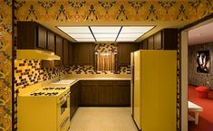 we had harvest gold appliances, dark wood cabinets and floral wallpaper just like this kitchen