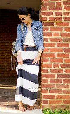 Black-and-white striped maxi skirt + white lace top + brown belt + denim jacket