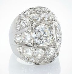 A DIAMOND AND PLATINUM 'MODELE FACETTE' RING, BY SUZANNE BELPERRON