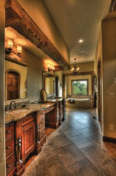 This bathroom has TWO walk in closets, one with a washer and dryer. DREAM BATHROOM!