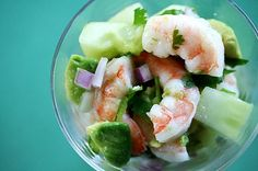Cool and tasty shrimp ceviche recipe, shrimp served with chopped red onion, chile, cilantro, cucumber, avocado with lemon and lime juices.