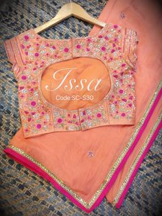 Pretty Peach saree and Peach blouse with hand work detailing. Saree Blouse Neck Designs, Saree Blouse Patterns, Dress Patterns, Sumo, Stylish Blouse Design, Blouse Models, Fancy Sarees, Beautiful Blouses, Indian Outfits