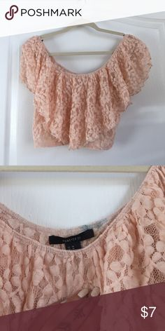 Ruffled pink lace crop top Ruffled pink lace crop top worn once size medium from Forever 21. Blue stain on the inside but can come out(shown in the picture) Tops Crop Tops