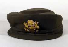 """This service cap was specifically designed for the Army Nurse Corps in 1942. Known at the time as the """"new service cap,"""" it was made of different types of materials to match either the winter olive drab, summer beige or dress white uniforms. This cap was worn with the winter uniform. The Army Nurse Corps cap is a distinctive item for nurses only. Learn more: http://bit.ly/zoLVy0"""