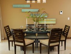 staggered wall hangings with a horizontal orientation.