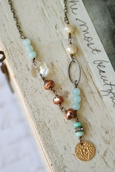 Grace... knew she was the center of attention features light blue jade gemstone beads,assorted glass beads,baroque glass pearls,brass charm,rhinestone bead,vintage crystal prism,antique brass chain measures 17 Matching bracelet and earrings sold seperately.