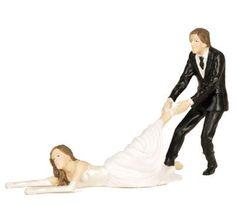 Una boda, un novio, una novia , una tarta y los muñecos de encima. Aquí un original muñeco. El novio coge a la novia que quiere escapar.