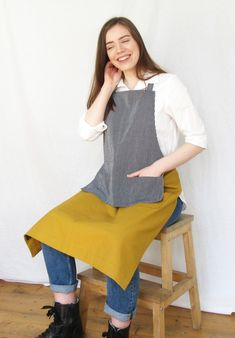 Striking and distinctive apron design, combining the comfort of a crossback apron, with the snug fit of a tie apron. Designed for artists & makers; handmade with sturdy medium-weight denim and canvas fabric- 4 pockets, for small tools, seed packets etc, Versatile apron for work, studio, home & garden. Canvas Fabric, Cotton Canvas, Apron Designs, Seed Packets, Aprons, Snug Fit, Navy And White, Work Wear, Mustard