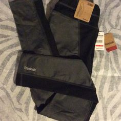 SaleReebok Skinny Pants New with tags. One small waistband pocket. Color is charcoal heather gray and black. Last picture is for fit only. Reebok Pants Track Pants & Joggers