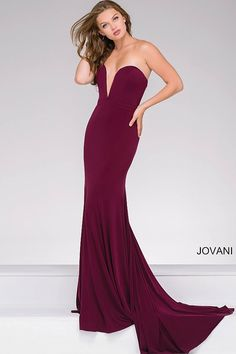 Sexy eggplant form fitting floor length jersey dress features strapless plunging sweetheart neckline, also available in blush and navy.