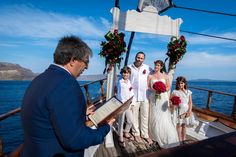 Celebrant, Family, Together, Vows, Happy, Smile, Forever, In Love, Wooden Boat, Caldera View, Santorini Weddings Red Wedding, Wedding Bride, Wedding Dresses, Santorini Island Greece, Santorini Wedding, Sailing Boat, Wedding Ceremonies, Happy Smile, Beauty Art
