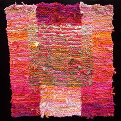 Pink & Tan floating square.   More peach, apricot and melon than outright orange, but it looks good on the board.  More like this at http://rugsfromrags.com/rugs-sold