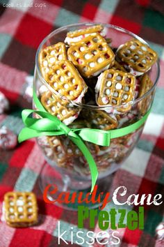 Candy Cane Pretzel Kisses (2 Ingredients: candy cane or your preferred flavor of Hershey Kisses & waffle-style pretzels)