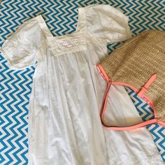 """Flash SaleChristiane Celle Embroidered Dress so pretty for vacation or Summer - a Christiane Celle for Calypso NWT embroidered smock style dress with short sleeves and hidden pockets. easy breezy 100% cotton. would make a beautiful swim cover-up too. I have thoroughly inspected and there are no stains or yellowing  but did find tiny 1/16"""" snag/ imperfection in fabric as photoed. please note tote bag listing separately - not included for this listing :) ** price is firm - just reduced…"""