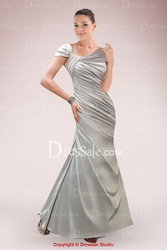 Unique in designing, this sheath mother of the bride gown is accentuated with off-the-shoulder straps and asymmetrical neckline. Fine pleats decorate the slim bodice while the flared skirt with side-draped flows down to the floor-length hemline. Bridesmaid Dresses, Prom Dresses, Formal Dresses, Bride Dresses, Bridesmaids, Mother Of The Bride Gown, Flare Skirt, Bride Groom, Evening Gowns