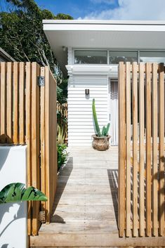 Kyal and Kara used airy sheer curtains in Alexandra Smoke to provide daytime privacy and a beautiful diffused light on sunny days, while minimalistic blockout roller blind provide added functionality without compromising on style. House Exterior, Holiday Home, House Design, Beach Bungalows, House Interior, Beach House Design, House Goals, Exterior, Fence Design