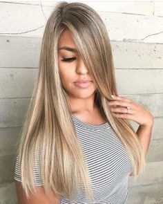 Long blonde hair with side-swept bangs by Karen Soriano