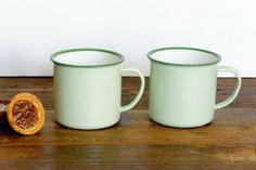 Pair of vintage enamel mugs