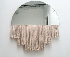 BEN & AJA BLANC. Half Moon Mirror   46 x 48 H inches   glass, silk, mohair, wool
