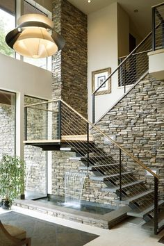 Contemporary Staircase with Metal staircase, travertine tile floors, Grays peak / ledge stone 150 sq ft pallet, Loft