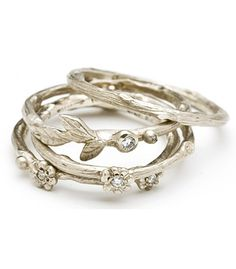 Textured twig stacking ring with three daisies, accented with diamonds (0.03 ctw). Flowers are asymmetrically spaced so that 1 is always facing the top 14k white gold
