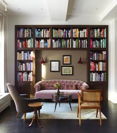 """Damon Liss designed this Tribeca loft for his family. """"Sometimes custom millwork like this is ideal to achieve a library feel. In other spaces, a beautiful vintage cabinet might make sense."""" The living room features his custom millwork, and the space also includes Kerstin Hörlin-Holmquist's Adam armchair, a teak conference chair by Pierre Jeanneret and a Martin Eisler coffee table."""