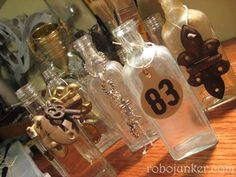 The smaller junk trinkets dress up old bottles beautifully. And who wants naked bottles?
